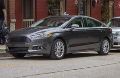 2014 Ford Focus Sedan Charcoal. 2014 Ford Focus Sedan.  Four door model with sporty wheels and charcoal exterior Royalty Free Stock Photo