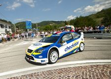 Ford fucus wrc. A Ford Focus WRC driven by Luca Pedersoli during the 2011 edition of the Rose'n'Bawl Rally in San Marino Republic , 29th July 2011 Royalty Free Stock Photography