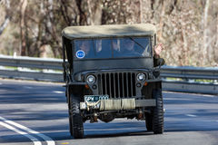 1942 Ford GPW Jeep. Adelaide, Australia - September 25, 2016: Vintage 1942 Ford GPW Jeep driving on country roads near the town of Birdwood, South Australia Stock Photos
