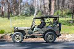 1943 Ford GPW Jeep driving on country road Royalty Free Stock Photo