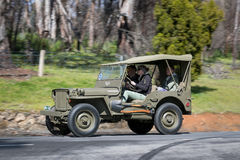 1943 Ford GPW Jeep driving on country road. Adelaide, Australia - September 25, 2016: Vintage 1943 Ford GPW Jeep driving on country roads near the town of Royalty Free Stock Photography