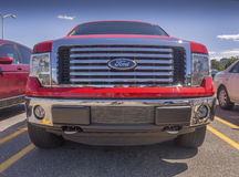 Ford grill. Massive Ford pick up truck 4 x 4 front grill against a blue sky Stock Photo