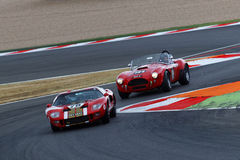 Ford GT40 and AC Cobra at the chicane Royalty Free Stock Image
