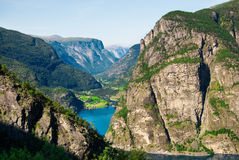 Fjord landscape in Norway. Scenery near Flam and Aurland - Norway, Scandinavia, Europe. Beautiful fjord and  small village on a lake coast Stock Photography