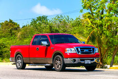 Ford Lobo. QUINTANA ROO, MEXICO - MAY 16, 2017: Red pickup truck Ford Lobo at the interurban road royalty free stock photography