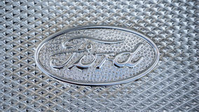 Ford Logo. A close up view of a retro stainless steel engraved Ford logo stock photo