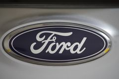Ford logo on a grey car, an American multinational automaker stock photography