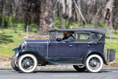 1930 Ford Model A Phaeton driving on country road Royalty Free Stock Photo