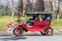 1911 Ford Model T Tourer driving on country road Stock Images