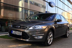 Ford Mondeo mk4. Close-up on new Ford Mondeo mark 4 in front of showroom Stock Photography