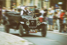 Ford 1924 on Motoclassic show in vintage effect, motion blur Stock Photos