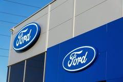 Ford motor company logo on dealership building Royalty Free Stock Photos