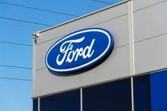 Ford motor company logo on dealership building Stock Image