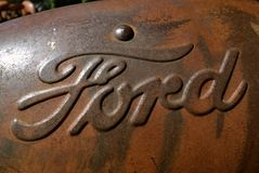 Ford Motor Company logo on an old tractor hood. DOWNER, MINNESOTA, October10, 2015: The rusty Ford  tractor hood logo is a product of the Ford Motor Company Royalty Free Stock Photo