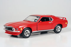 Ford Mustang 1969. 1969 Ford Mustang, red, Road Champions 1:43 scale die-cast scale model, issued in 1999 royalty free stock image
