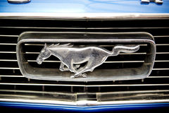 Ford Mustang. Famous Logo With A Running Horse : Logo Of An 1966 Ford Mustang stock photography