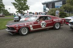 1969 ford mustang boss 302 race car. Picture of vintage ford mustang boss 302 race car in display before the race during the U. S vintage grand prix at watkins stock image