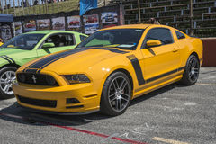 Ford mustang boss 302. Sanair august 9, 2014 front side view of 2013 ford mustang boss 302 with grabber orange paint color at 19e super ford show royalty free stock photos