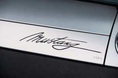 Ford Mustang car logo on the retro dashboard Royalty Free Stock Photo