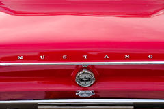 Ford Mustang car logo on the retro hood. Stock Photography