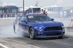 Ford mustang cobra jet making a smoke show at the starting line Royalty Free Stock Photo