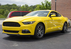 2015 Ford Mustang Coupe. Bright yellow 2015 Ford Mustang.  Front and side view of the new 6 cylinder coupe Stock Photography