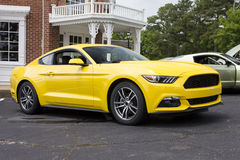 2015 Ford Mustang Coupe. Bright yellow 2015 Ford Mustang six cylinder coupe Royalty Free Stock Photography