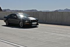 Ford Mustang. Crossing Hover dam bridge stock photography