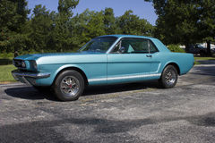 1966 Ford Mustang GT Coupe. 1966 Ford Mustang coupe. Turquoise exterior with white GT side stripes, fog lamps, styled steel wheels. A fine example of an American royalty free stock photo