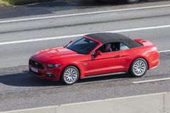 Ford Mustang on the highway Stock Images