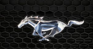 Ford Mustang metallic logo closeup on Ford Mustang  car displayed at  MOTO SHOW in Cracow Poland. Exhibitors present  most interesting aspects of the Stock Image