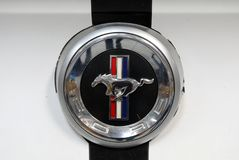 Ford Mustang metallic logo closeup on Ford Mustang car displayed at MOTO SHOW in Cracow Poland. royalty free stock image