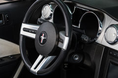 Ford Mustang retro car wheel and dashboard Royalty Free Stock Image