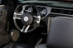 Ford Mustang retro car wheel and dashboard Stock Photos