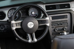 Ford Mustang retro car wheel and dashboard Royalty Free Stock Photos