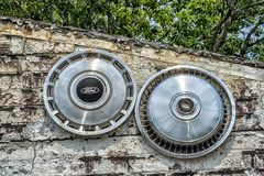 Ford old hubcap royalty free stock image