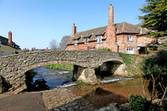 Ford and packhorse bridge at Allerford, Somerset. A picture-postcard English Village in northern Somerset in Springtime showing the ford, bridge River Aller and Royalty Free Stock Images