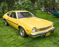 1976 Ford Pinto Runabout. GROSSE POINTE SHORES, MI/USA - JUNE 21, 2015: A 1976 Ford Pinto Runabout car at the EyesOn Design car show, held at the Edsel and Royalty Free Stock Images