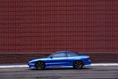 Ford Probe Blue. Blue Ford Probe behind a red brick wall stock images