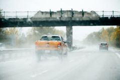 Ford Ranger pick-up driving on heavy rain Royalty Free Stock Photo