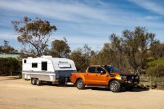 Ford Ranger Wildtrack off road pickup car with air intakes and a white caravan trailer in Western Australia. HYDEN, WESTERN AUSTRALIA - JULY 1, 2018: Ford Ranger stock photography