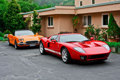 Ford Red GT and Chevy Corvette. Picture taken in Carmel California in 2012 Stock Photo
