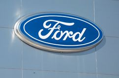 Ford Dealership Sign And Logo Against Silver Building, Detroit, October 17, 2017. Ford sign from a dealership near Detroit, Michigan shot on a sunny clear blue Stock Images