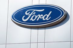 Ford Dealership Sign And Logo Against Silver Building, Detroit, October 17, 2017. Ford sign from a dealership near Detroit, Michigan shot on a sunny clear blue Royalty Free Stock Image