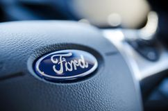 Ford sign on steering wheel close up. WROCLAW, POLAND - DEC 13, 2017: Ford sign on steering wheel close up. Ford is the most popular car on the aftermarket in Stock Photos
