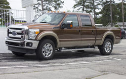 2015 Ford Super Duty Truck. A 2015 Ford F250 Super Duty diesel truck, four door.  Side and partial front view. Ford Powerstroke, King Ranch edition.  Chrome Royalty Free Stock Photos