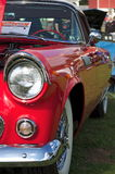 Side view of a classic 1955 Ford Thunderbird in cherry red Royalty Free Stock Photography