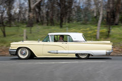 1959 Ford Thunderbird coupe. Adelaide, Australia - September 25, 2016: Vintage 1959 Ford Thunderbird coupe driving on country roads near the town of Birdwood Stock Images