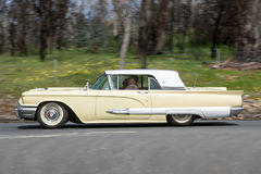 1959 Ford Thunderbird coupe. Adelaide, Australia - September 25, 2016: Vintage 1959 Ford Thunderbird coupe driving on country roads near the town of Birdwood Royalty Free Stock Photography