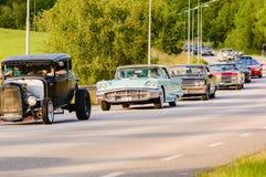 Ford thunderbird 1960. Ronneby, Sweden - June 26, 2015: Veteran car street cruise on public roads. Ford thunderbird 1960 green in caravan royalty free stock photo